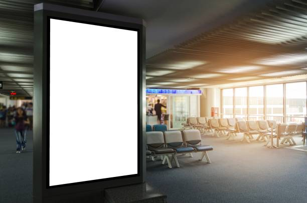 mock up of vertical blank advertising billboard or light box showcase with waiting cone at airport, copy space for your text message or media content, advertisement, commercial and marketing concept - lotnisko zdjęcia i obrazy z banku zdjęć