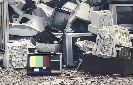 Mock up old tv screen. Unwanted televisions piled up for recycling at government collection point.