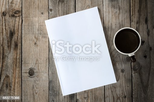 istock mock up on wood background with cup of coffee 683275366