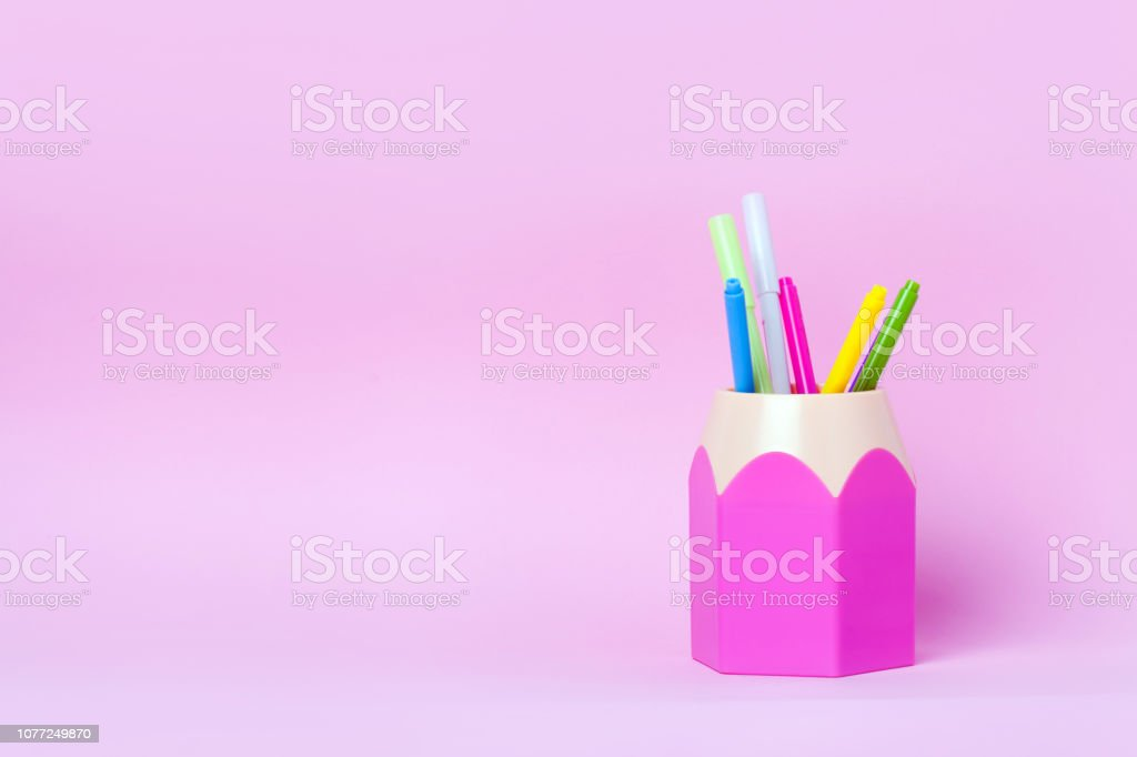 Mock up picture of pencil holder on pink background. Close up,...