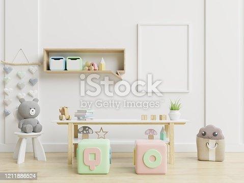 1208254898 istock photo Mock up poster frame in children room,kids room,nursery mockup. 1211886524