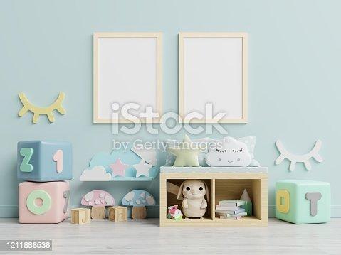 1208254898 istock photo Mock up poster frame in children room,kids room,nursery mockup. 1211886536