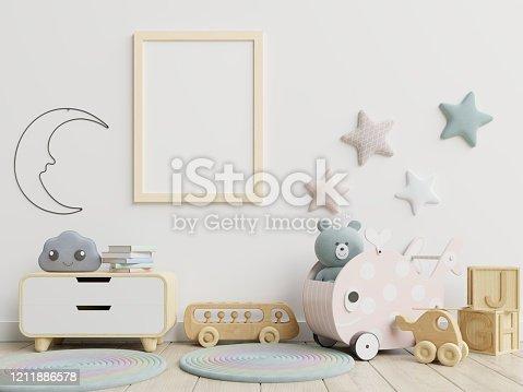 1208254898 istock photo Mock up poster frame in children room,kids room,nursery mockup. 1211886578