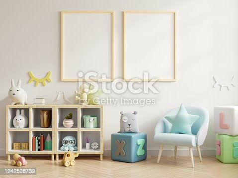 1208254898 istock photo Mock up poster frame in children room,kids room,nursery mockup. 1242528739