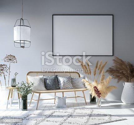 1027116110 istock photo Mock up poster frame in home interior background, Bohemian style living room 1069232000
