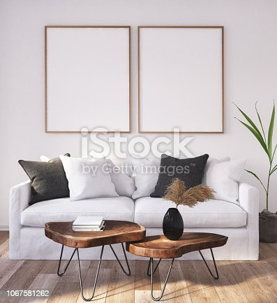 1027116110 istock photo Mock up poster frame in home interior background, Scandinavian Bohemian style living room 1067581262