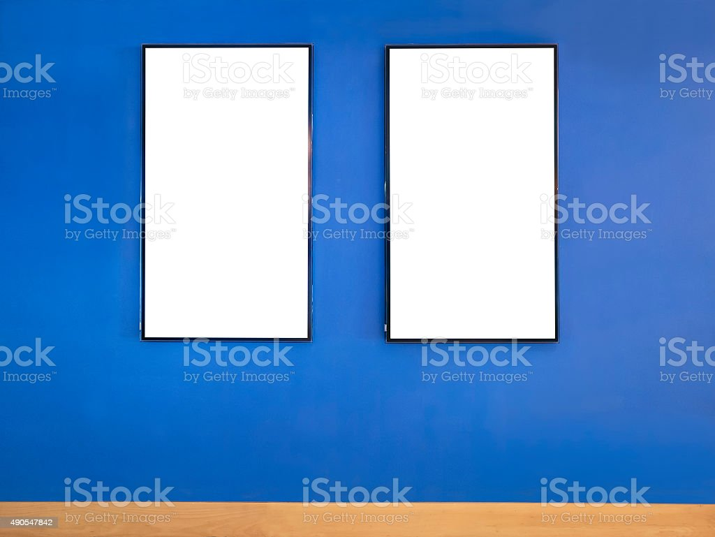 Mock up poster frame on Blue wall stock photo