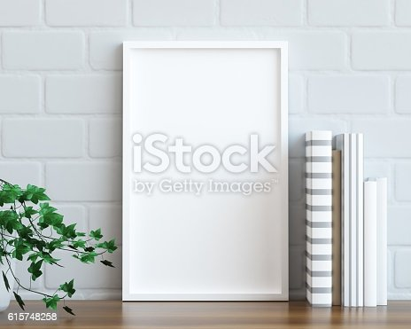 istock Mock up poster frame on the table 615748258
