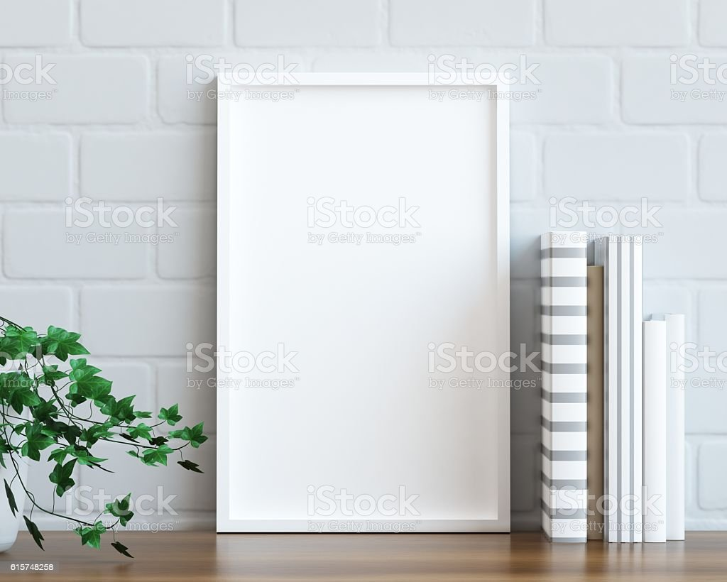 Mock up poster frame on the table stock photo