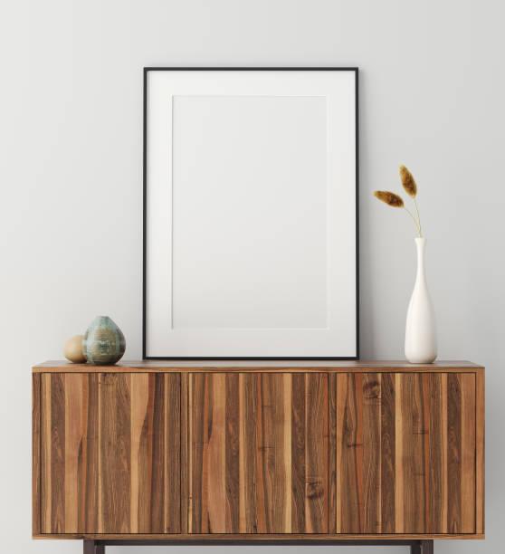 mock up poster frame op houten kast in huis interieur - plank meubels stockfoto's en -beelden