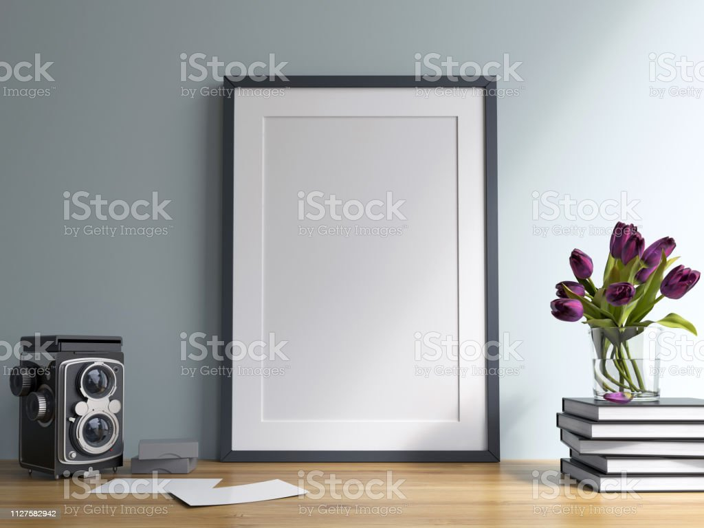 Mock up poster frame Mock up poster frame with books and flowers Apartment Stock Photo