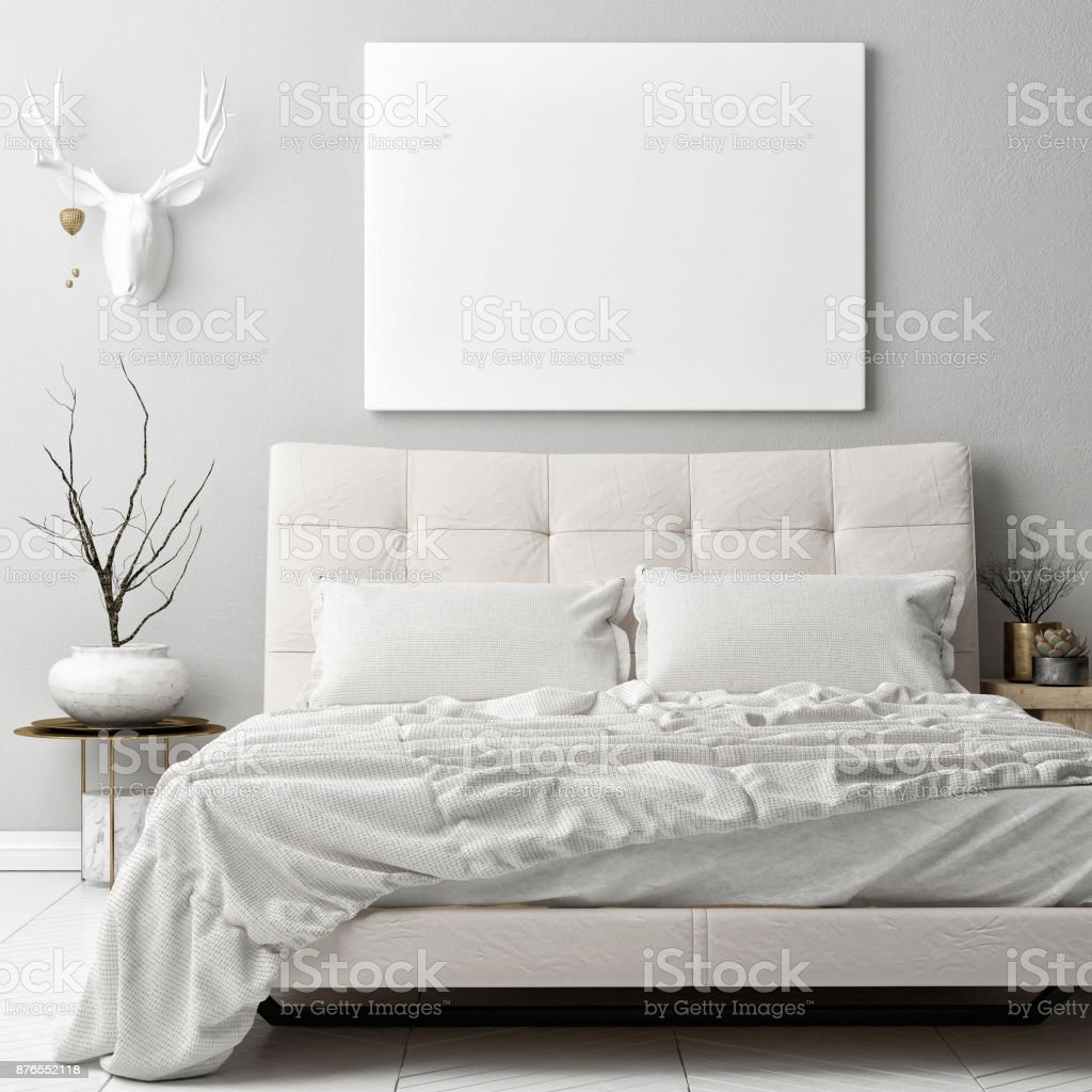 Mock up poster in hipster bad room , deer horns decoration on the wall stock photo