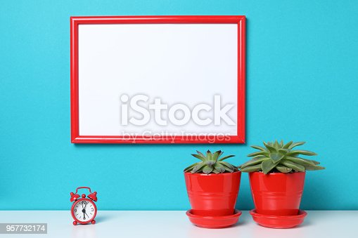 518847146istockphoto Mock up poster in the interior. 957732174