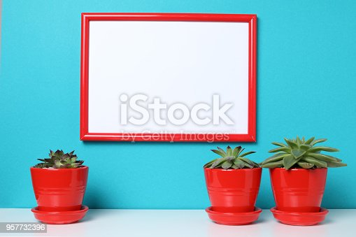 518847146istockphoto Mock up poster in the interior. 957732396
