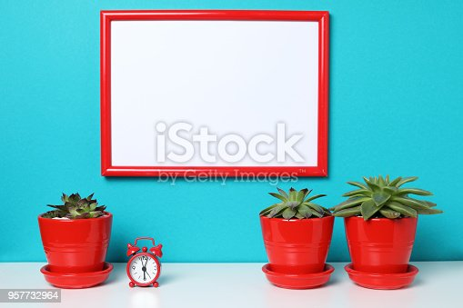 518847146istockphoto Mock up poster in the interior. 957732964