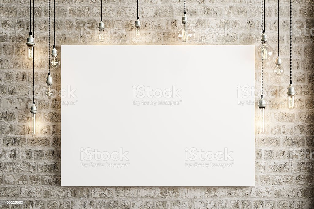 Mock up poster with ceiling lamps and a rustic brick stock photo
