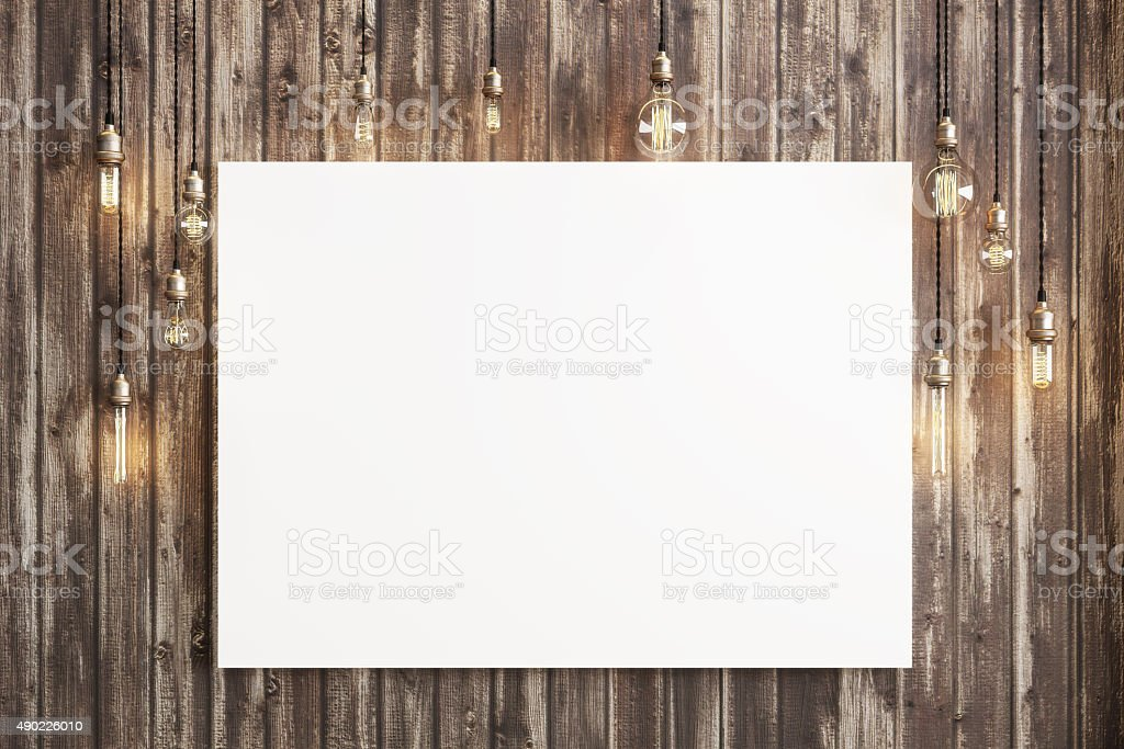 Mock up poster with ceiling lamps and a rustic wood stock photo