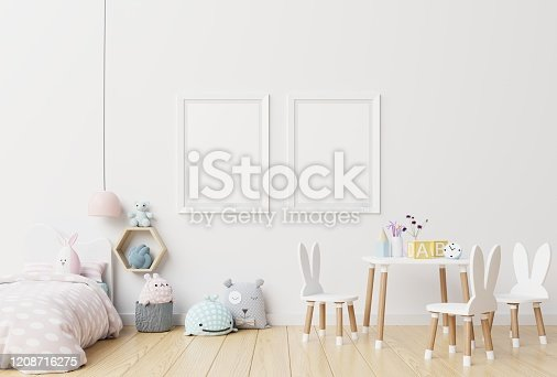 istock Mock up posters in child room interior. 1208716275