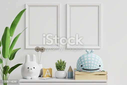 1208254898 istock photo Mock up posters in child room interior. 1208716287