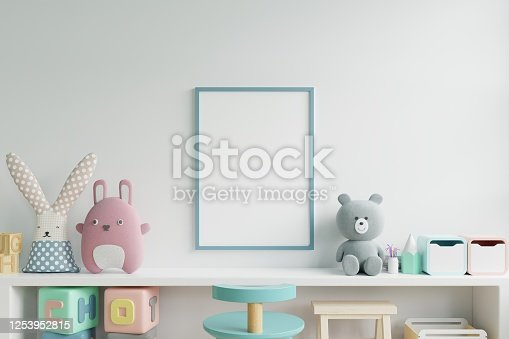 1205865899 istock photo Mock up posters in child room interior, posters on empty white wall background. 1253952815