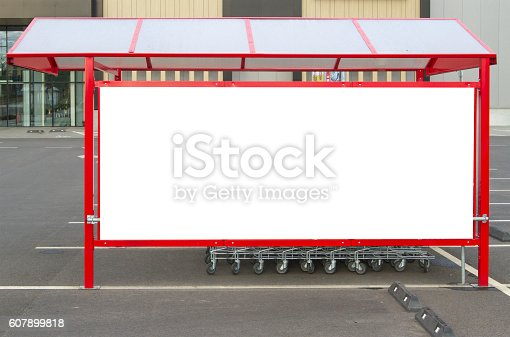 istock Mock up. Shopping carts return point on a parking lot 607899818