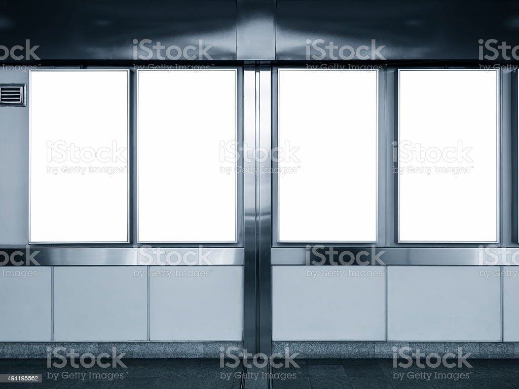 Mock up Vertical Ad Blank Posters display in Subway station stock photo