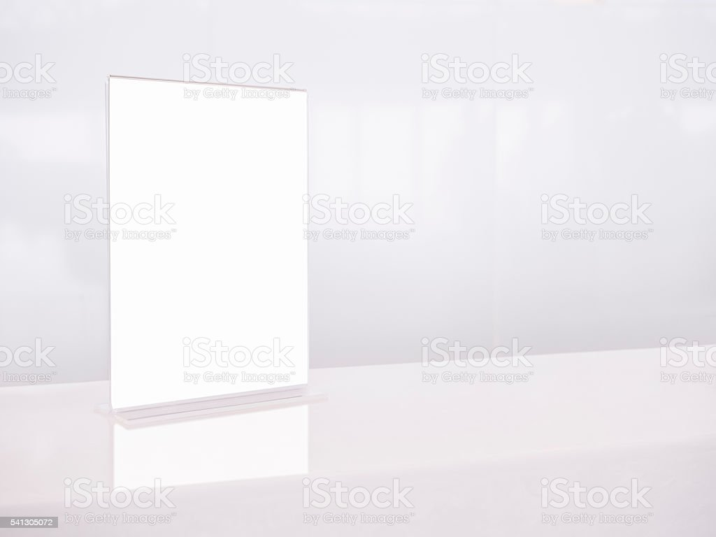 Mock up White template Menu frame on Table Counter stock photo