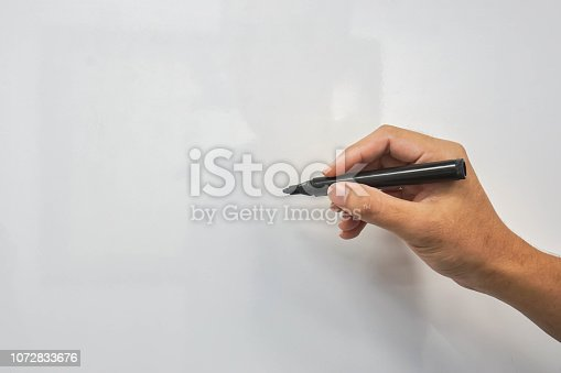 mock up whiteboard with man hand hold marker pen for writing