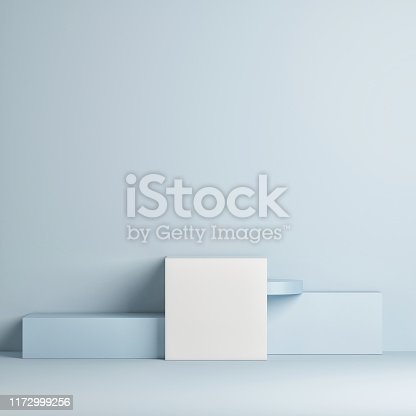 1079254746istockphoto Mock up winner podium, minimal design, blue background 1172999256