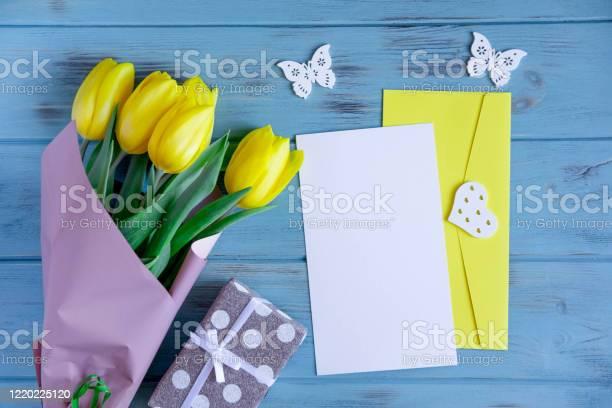 Mock up with a bouquet of yellow tulips closeup on a blue wooden a picture id1220225120?b=1&k=6&m=1220225120&s=612x612&h=mhutg xewgwxjjtcwrby83gkihalxchhcsgmog8wzvm=