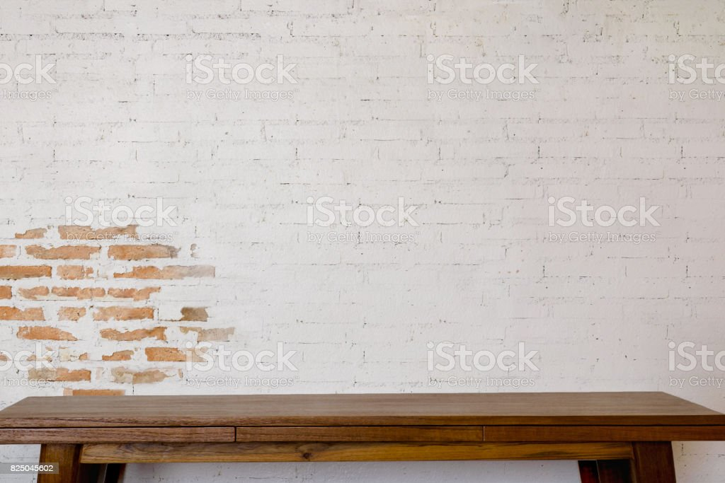 Mock up wooden table with white brick wall. For product display montage. stock photo