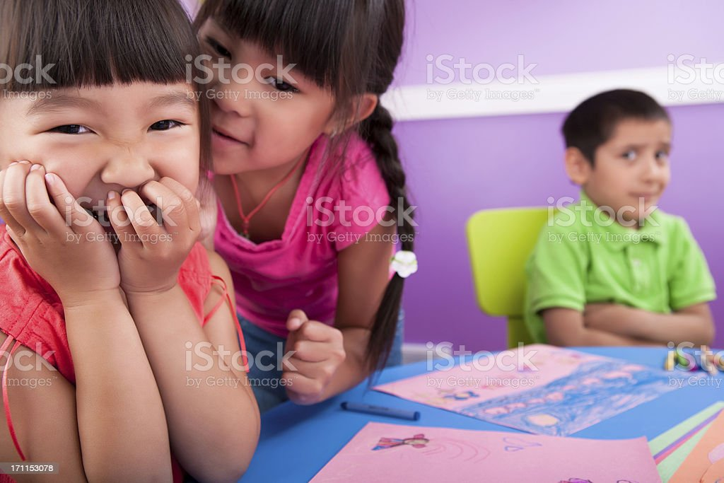 Mocking and gossip in class stock photo
