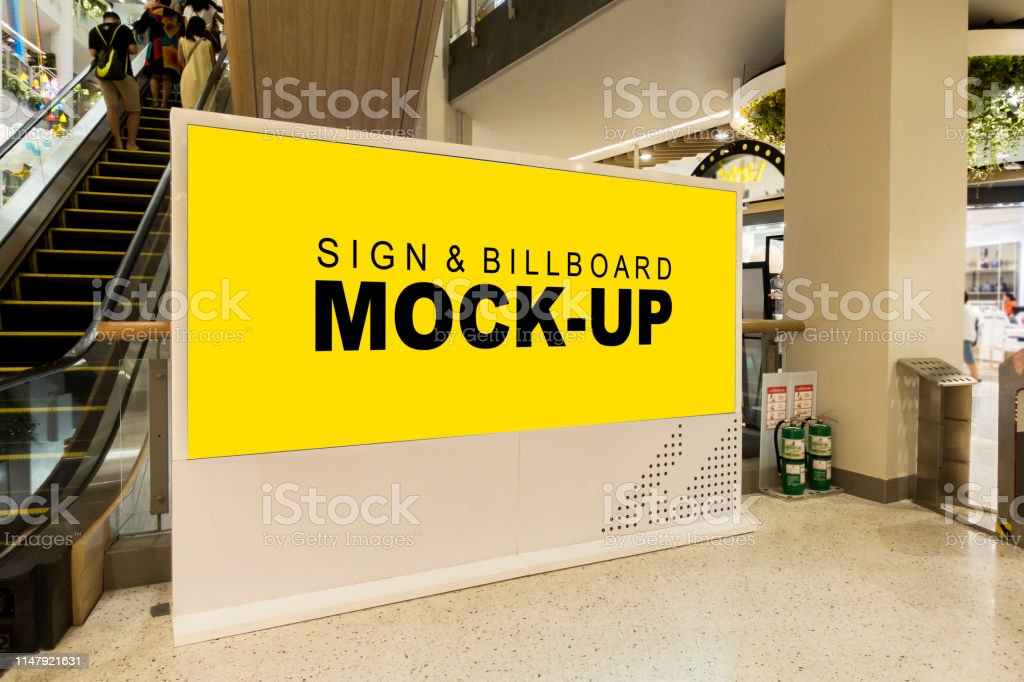 Mockup Blank Yellow Screen Billboard Near Escalator In Shopping