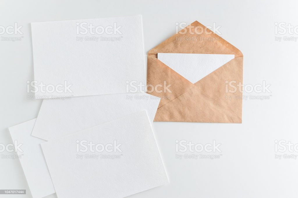 Mockup Brown Kraft Envelope And Enpty Cards On White Background Stock Photo  - Download Image Now