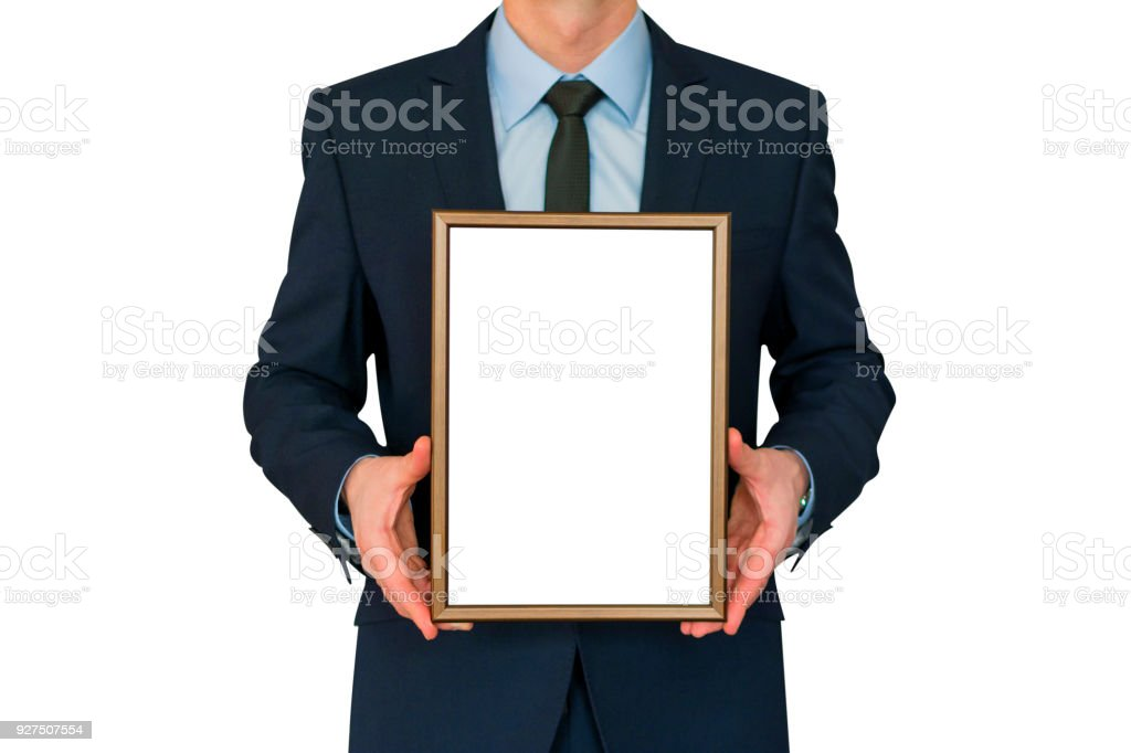 Mockup. Business man holding in hands empty blank photo frame. stock photo