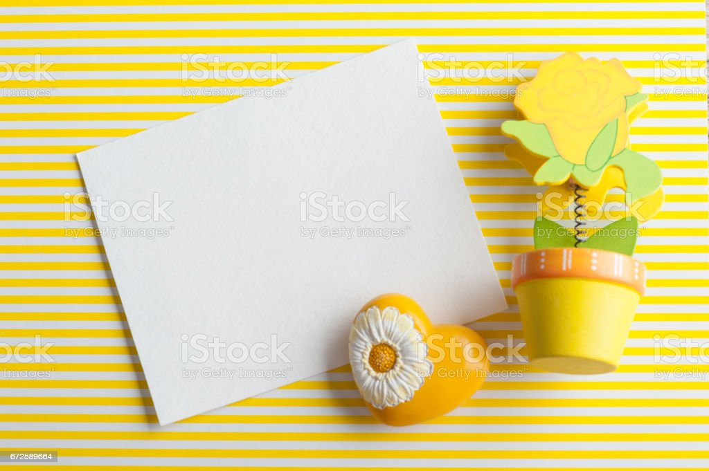 Mock-up, empty paper note, yellow wooden flower stock photo