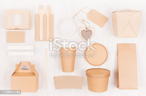 istock Mockup food takeaway packaging for cafe and restaurant - heart, cardboard boxes for coffee, burger, noodles, sandwich, sushi on light white wood table. 1126401293