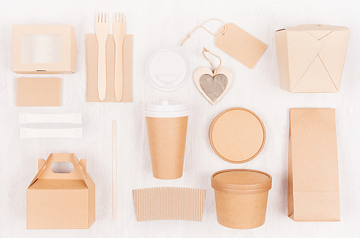 Mockup food takeaway packaging for cafe and restaurant - heart, cardboard boxes for coffee, burger, noodles, sandwich, sushi on light white wood table.