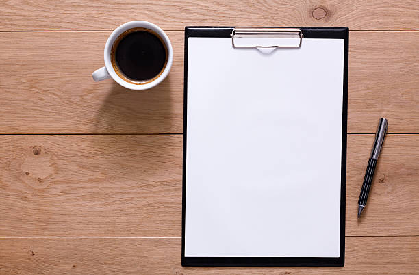 Mockup for checklist, note paper and coffee on wood background - foto de acervo
