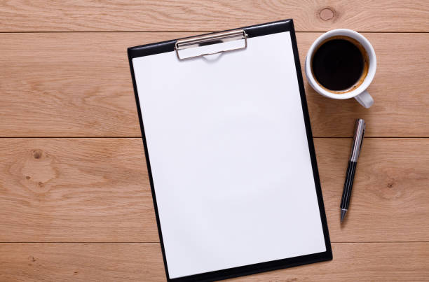 Mockup for checklist, note paper and coffee on wood background stock photo