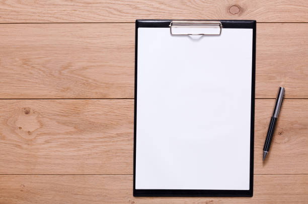 Mockup for checklist, note paper on wood background stock photo