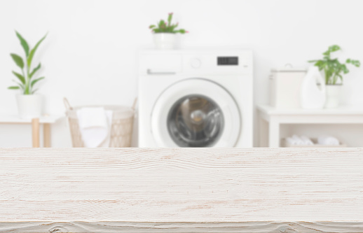 Mock-up for design of empty wooden table in laundry room