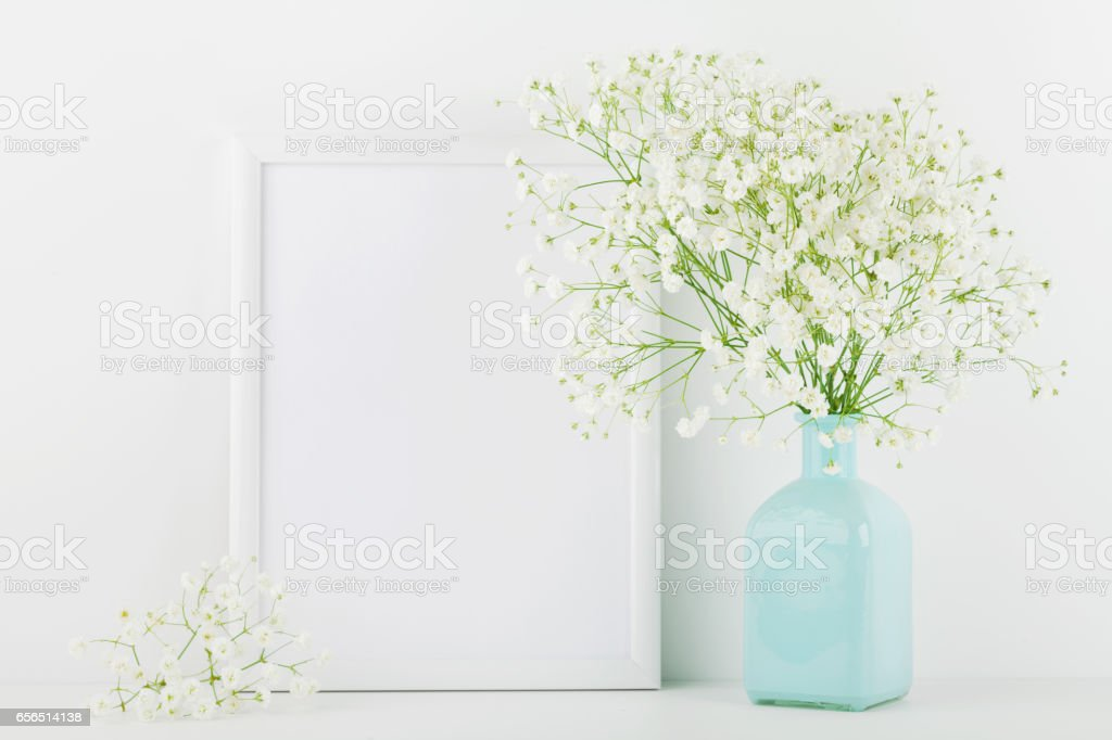Mockup for website design and blogging. Picture frame decorated flowers in vase. stock photo