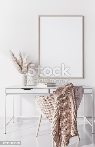 Mockup frame for white wooden desk, home office Scandinavian design with pampas grass and white trendy furniture, 3d render