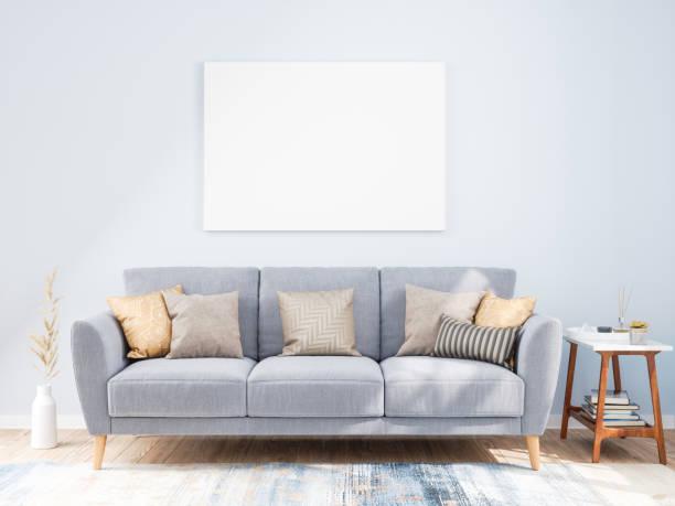 ソファーが付いている居間の壁のモックアップフレーム - ソファ ストックフォトと画像