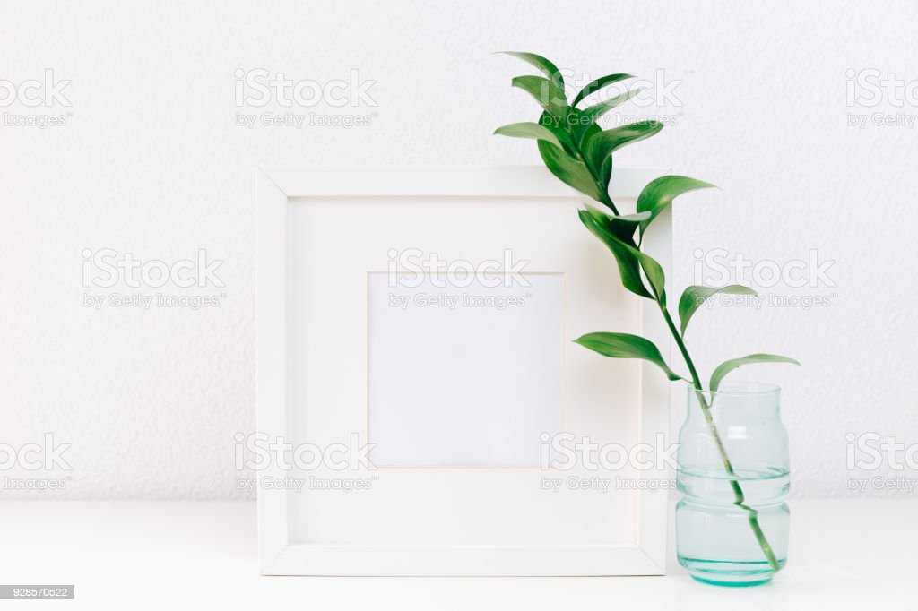 Mockup Frame With A Green Branches In Vase On Table On Minimal