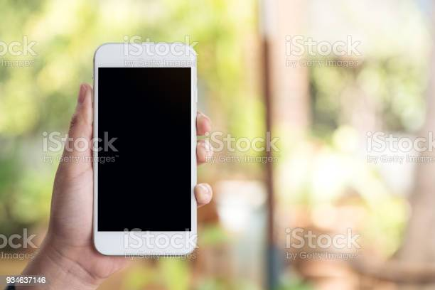 Mockup image of a hand holding and showing white smart phone with picture id934637146?b=1&k=6&m=934637146&s=612x612&h=rinxunfh50xsznb1ep5v00g8bypx6eglxd gz srmcq=