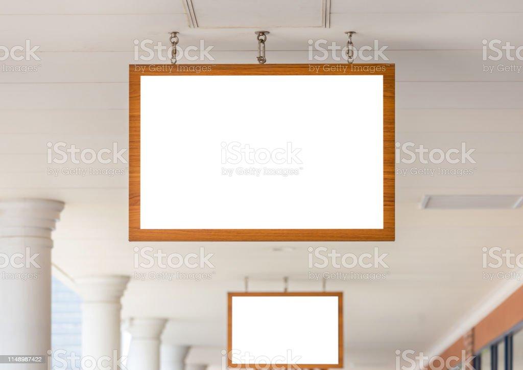 Mockup image of Blank billboard wood frame white screen outside...
