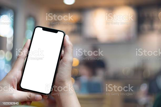 Mockup image of hand holding mobile phone with blank white full in picture id1023262640?b=1&k=6&m=1023262640&s=612x612&h=h8rf0qqlzvopcavvw9v66znmibhip ainj jgbvjicw=