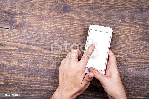 istock Mockup image of hands holding white mobile phone with blank white screen 1166150358